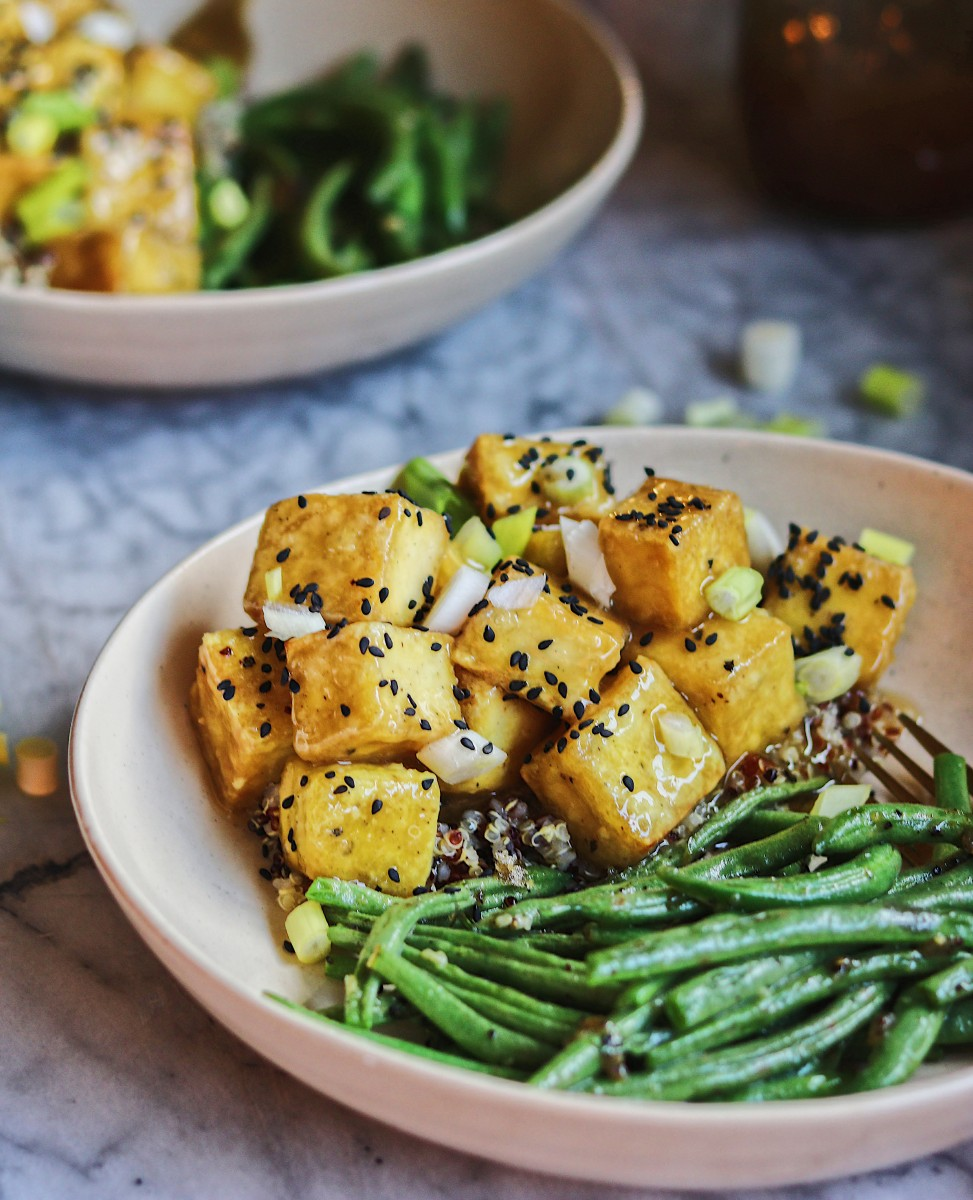 Close up or orange tofu and green beans