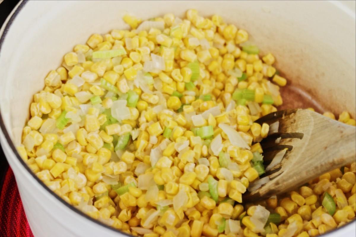 Onion, celery, sweet corn in pot