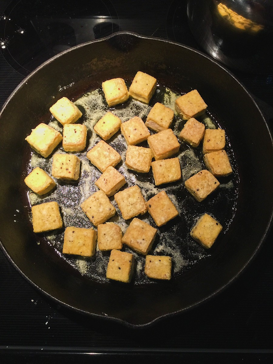 Tofu browning in a pan